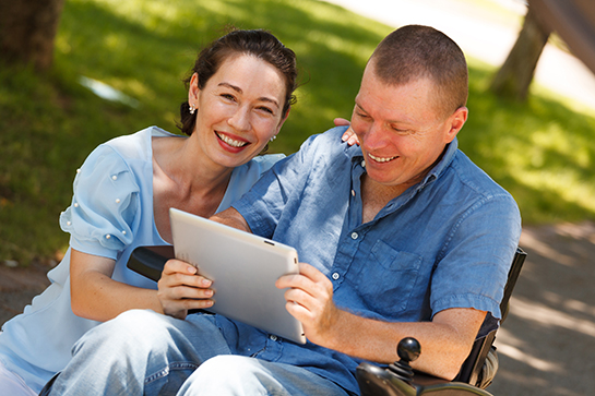Person-centered Woman and Man Looking at iPad