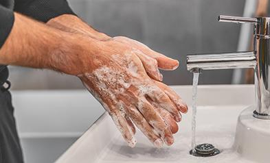 Thoroughly washing hands