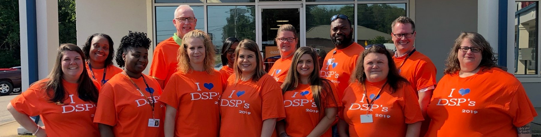 Who We Are banner image with DSP t shirts