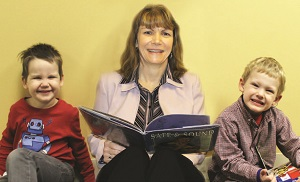 Cathy reading to children