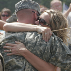Service member and significant other embracing